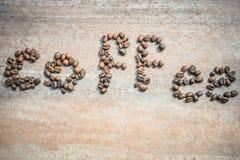 Кофейные зерна как кофе слова Стоковое Изображение