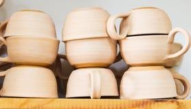 Кофейные чашки в работе на студии Стоковое Фото