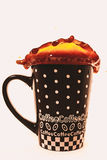 Кофе брызгая из чашки Стоковая Фотография RF