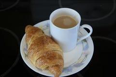 Кофе и круасант стоковые изображения