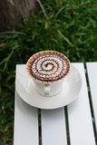 Кофе картины дизайна в белой чашке Стоковые Изображения RF
