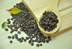 Кофе на деревянной предпосылке Стоковые Фото
