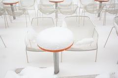 кофе покрыл таблицы снежка Стоковое Изображение