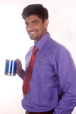 кофе счастливого бизнесмена выпивая в офисе Стоковое Изображение RF