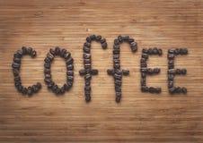 ` Кофе ` слова сделанное от кофе-фасолей Стоковое Фото