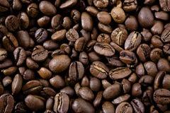 кофе фасолей предпосылки зажарил в духовке Стоковое Фото