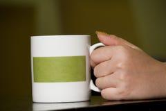 Кофе чашки взятия руки Стоковые Изображения