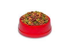 Кошачья еда в красном шаре изолированном на белизне Стоковое фото RF