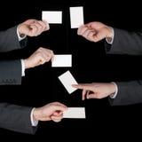 Коллаж визитных карточек владением рук на черноте Стоковые Фото