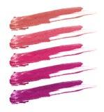 Коллаж декоративной губной помады косметик на белой предпосылке Красота и концепция состава Стоковые Фотографии RF
