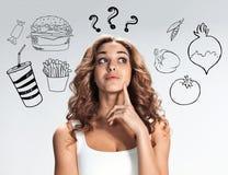 Коллаж молодой красивой женщины с здоровой и вредной едой Стоковое фото RF