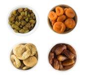 Коллаж различных высушенных плодоовощей Изюминки, даты, высушенные абрикосы, смоква изолированная на белой предпосылке Стоковое Изображение
