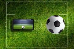 Коллаж футбола с ПК шарика, поля и таблетки стоковое изображение rf