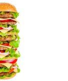 Кола и большой гамбургер на белой предпосылке Стоковые Изображения