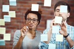 Коллеги делая бизнес-план на встрече Стоковое Изображение