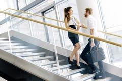 Коллеги дела говоря на лестницах Стоковые Изображения RF