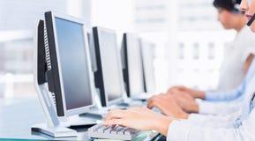 Коллеги дела используя компьютеры Стоковые Изображения