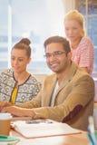 Коллеги используя компьтер-книжку на офисе Стоковые Изображения RF