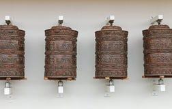 Колеса молитве на буддийском виске Стоковая Фотография