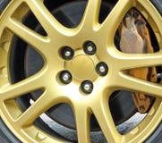 Колесо гонок золота sportscar Стоковые Изображения