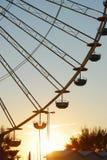 Колесо Ferris на восходе солнца стоковое фото