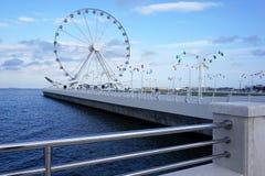 Колесо Ferris около Каспийского моря стоковые фотографии rf
