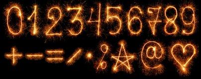 Количества и другие символы бенгальских огней дальше стоковая фотография