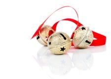 Колокол звона рождества с красной лентой Стоковые Фото