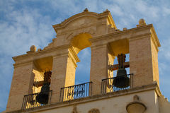 Колоколы на соборе Севильи на заходе солнца Испания Стоковое Изображение RF