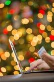 колоколы предпосылки чешут белизна красной покупкы кредита рождества изолированная праздником sparkly Стоковые Изображения