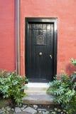 Колониальная черная дверь Стоковые Изображения