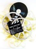 Колотушка кино на фильме и кино 35mm желтых развернутых наматывает Стоковое фото RF