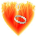 Кольца в горящем сердце Стоковое Фото