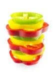 Кольца красных, зеленых и желтых перцев Стоковая Фотография