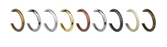 Кольца металла с зажимами для карнизов занавеса Стоковые Фото