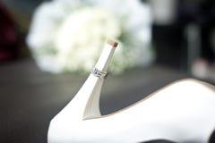Кольцо и ботинки Стоковое Фото