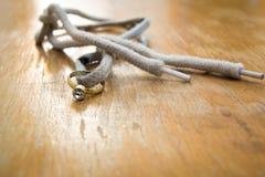 Кольцо с бриллиантом на шнурке Стоковые Изображения