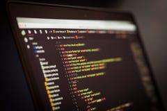 Код HTML и CSS на экране компьтер-книжки Стоковое Изображение RF