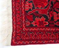 Край старого красного персидского ковра Стоковые Изображения RF