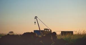 Кран груза на поле Стоковые Изображения RF