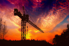 Кран на заходе солнца Стоковое Изображение RF