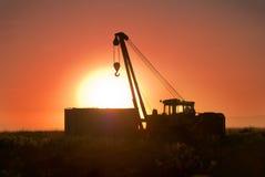 Кран тележки в поле на зоре Стоковые Фото