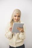 Красивая азиатская девушка с планшетом Стоковое фото RF