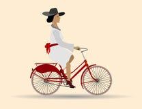 Красивая дама на красном велосипеде Стоковое Фото