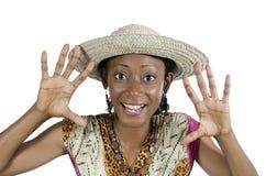 Красивая африканская женщина показывая руки и усмехаться стоковая фотография
