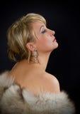 Красивая блестящая женщина в студии стоковое фото rf