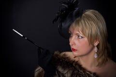 Красивая блестящая женщина в студии стоковая фотография