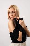 Красивая блондинка на белой предпосылке Стоковые Фото