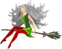 Красивая ведьма сидя на венике Стоковые Изображения RF