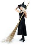 Красивая ведьма с веником Стоковая Фотография